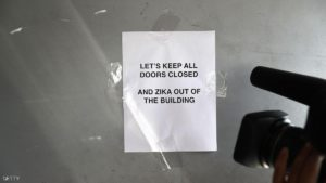 MIAMI, FL - AUGUST 04:  A sign reads, 'Lets keep all doors closed and Zika out of the building', on a building in the Wynwood neighborhood where the Zika virus has been found on August 4, 2016 in Miami, Florida. With the Zika virus in the neighborhood the CDC has advised pregnant women to avoid the area.  (Photo by Joe Raedle/Getty Images)