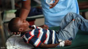 PORT-AU-PRINCE, HAITI - NOVEMBER 26:  Alexandre Saint-Cyr, 6, is given aid as he lays on his cot while being treated for cholera in an International Red Cross cholera treatment facility in the slum neighborhood of Cite Soleil on November 26, 2010 in Port-au-Prince, Haiti.  Haiti continues to deal with a cholera epidemic that has killed more than 1,400 with thousands more sick. Doctors say it is caused by poor sanitary conditions that make the bacteria easy to transmit through contaminated water or food.  (Photo by Joe Raedle/Getty Images)