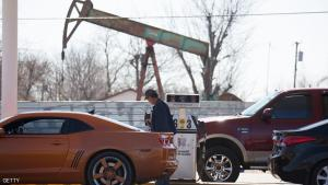 OKLAHOMA CITY, OK - FEBRUARY  12: A motorist fills his car with gas at a gas station near an oil field pumping rig February 12, 2016 in Oklahoma City, Oklahoma.  Earlier this week gas stations were posting cheaper prices, many lower than $1.10 a gallon,  but most gas stations in Oklahoma City were posting higher gas prices today. Prices are expected to start inching upward as spring approaches and refiners begin to throttle back on production to combat oversupply at the same time that demand begins to rise. (Photo by J Pat Carter/Getty Images) *** Local Caption