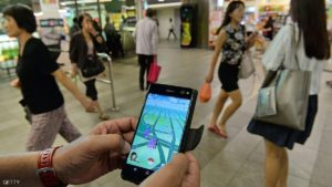 A man shows the Pokemon Go game on his smartphone while hunting outside a SMRT train station in Singapore on August 11, 2016. Pokemon Go was available in nine countries on August 6, including Singapore. / AFP / ROSLAN RAHMAN (Photo credit should read ROSLAN RAHMAN/AFP/Getty Images)