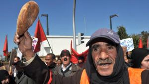 A Moroccan army veteran, who was held prisoner by Polisario fighters, holds a bread loaf as he gathers along with others veterans and their relatives during a demonstration to ask for ''justice and dignity'' and a pension increase to the King on February 23, 2012 in Rabat. Morocco annexed Western Sahara in 1976 after a Spanish withdrawal, and Polisario fighters took up arms for an independent state. AFP PHOTO / ABDELHAK SENNA (Photo credit should read ABDELHAK SENNA/AFP/Getty Images)