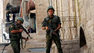 Members of Palestinian security forces take position during a raid following clashes with Palestinian gunmen in the old town of the West Bank city of Nablus, August 19, 2016. REUTERS/Abed Omar Qusini