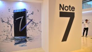 A man stands by signboards of Samsung Galaxy Note7 during a showcase to mark its domestic launch in Seoul on August 11, 2016. The Note7 will be available starting August 19, with a price of 988,900 won (897 USD) in South Korea. / AFP / JUNG YEON-JE (Photo credit should read JUNG YEON-JE/AFP/Getty Images)