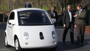 MOUNTAIN VIEW, CA - FEBRUARY 02: Google's Chris Urmson (R) shows a Google self-driving car to U.S. Transportation Secretary Anthony Foxx (L) and Google Chairman Eric Schmidt (C) at the Google headquarters on February 2, 2015 in Mountain View, California. U.S. Transportation Secretary Anthony Foxx joined Google Chairman Eric Schmidt for a fireside chat where he unveiled Beyond Traffic, a new analysis from the U.S. Department of Transportation that anticipates the trends and choices facing our transportation system over the next three decades. (Photo by Justin Sullivan/Getty Images)