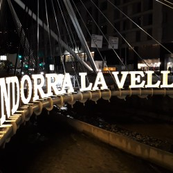 Andorra La Vella, Andorra– October 27, 2018: Sign upon Paris Bridge on La Valira River in Andorra La Vella.