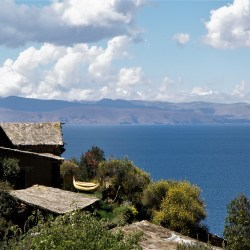 Isla del Sol, Bolivia – August 22, 2013: Traditional houses and Titicaca lake view.