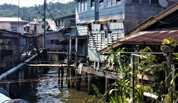 Kampong Ayer, Brunei – July 17, 2015: Old houses over the water in Kampong Ayer, a historic settlement area in Bandar Seri Begawan made of a cluster of traditional stilt villages built on the Brunei River.