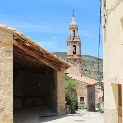 Old public laundries and Iglesia de Santa María Magdalena in Tronchón, Spain