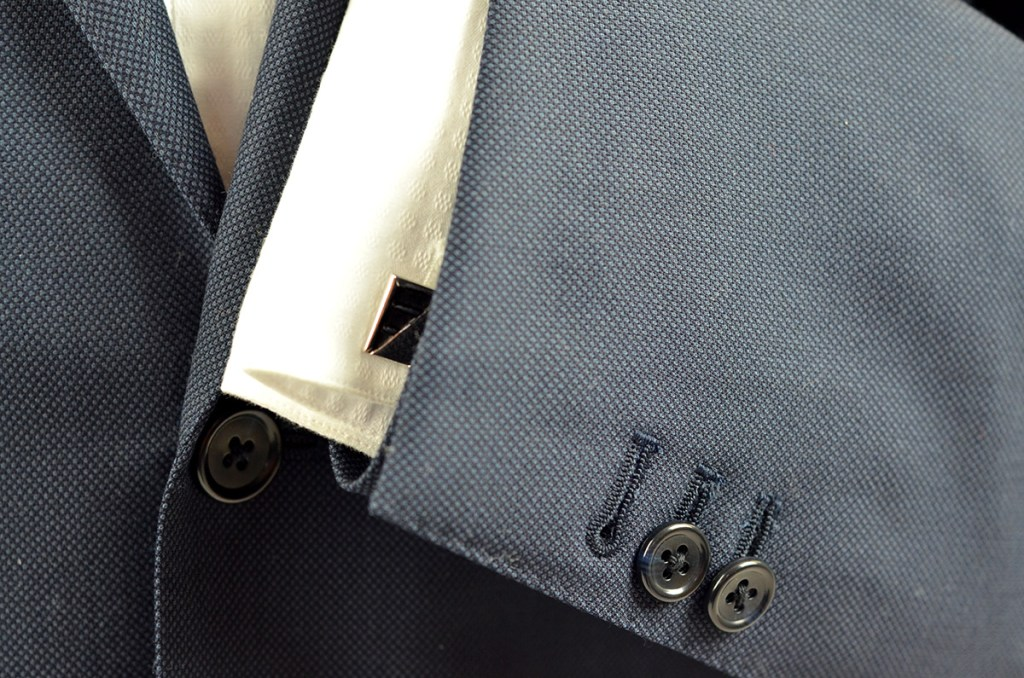working buttons on bespoke suit