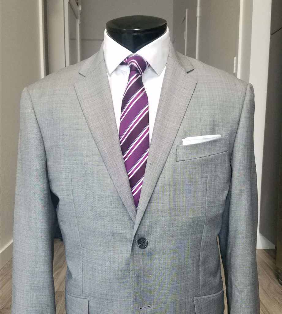 a purple tie with a grey suit