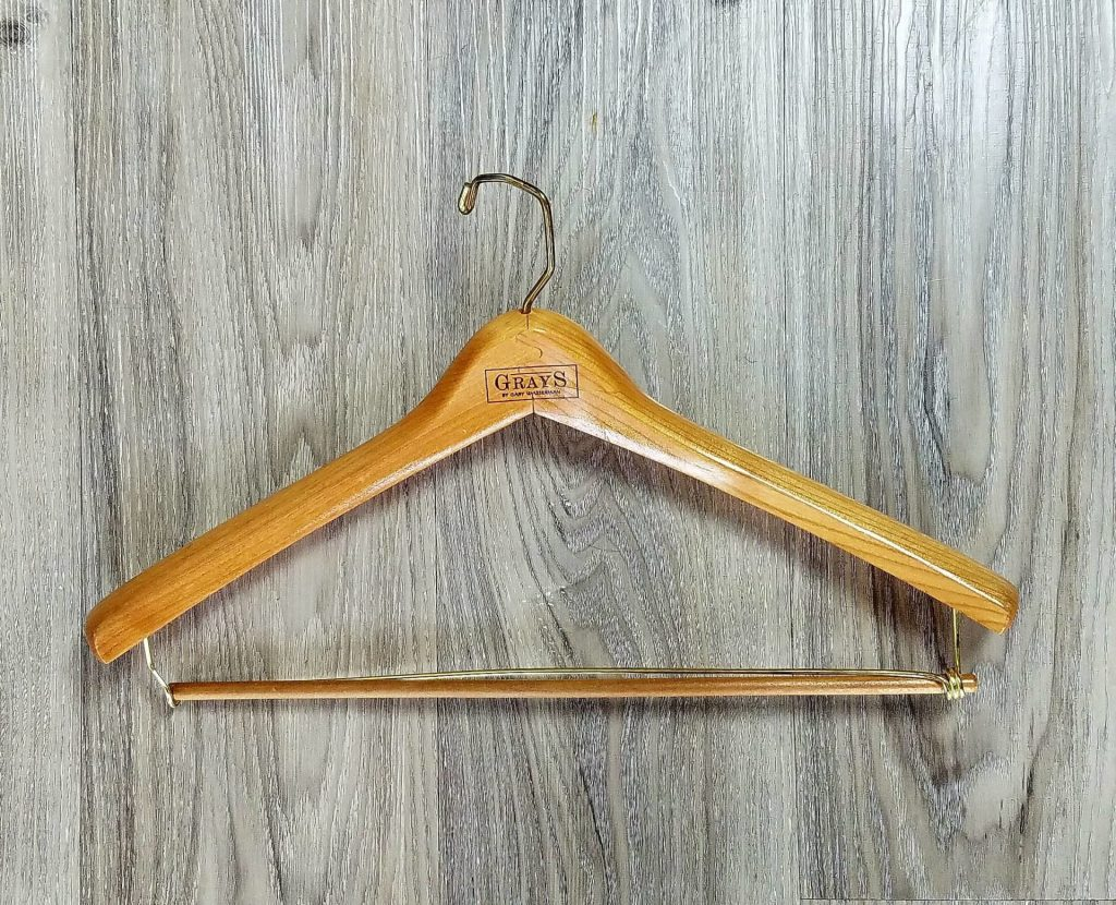 How to take care of your suit with a wooden suit hanger