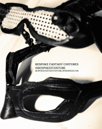 Catwoman mask, image 3. Showing side view with LED light visor lifted. Design altered, 3d printed and constructed by Bespoke Fantasy Costumes. Photography by Rose-Sky Journey Pieces. 2017.