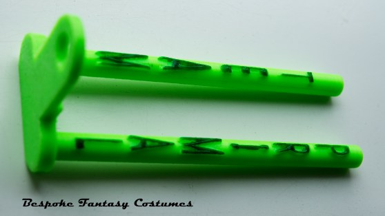 Fishing rod snag ears. Re-designed and made by Bespoke Fantasy Costumes, 2017. These can be customised with any name on the base plate, and along the snag ears. Available in a number of colours. We can also adjust the snag ear length and base width to fit your chosen fishing rod. Photography by Rose-Sky Journey Pieces, 2017.
