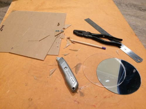 Cutting the clear perspex and the acrylic mirror