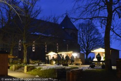 Small Christmas market at dusk.