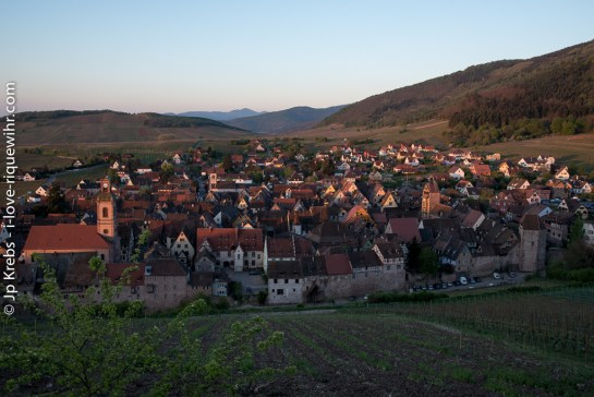 Rising sun at springtime in Riquewihr seen from the vineyards of Schoenenbourg