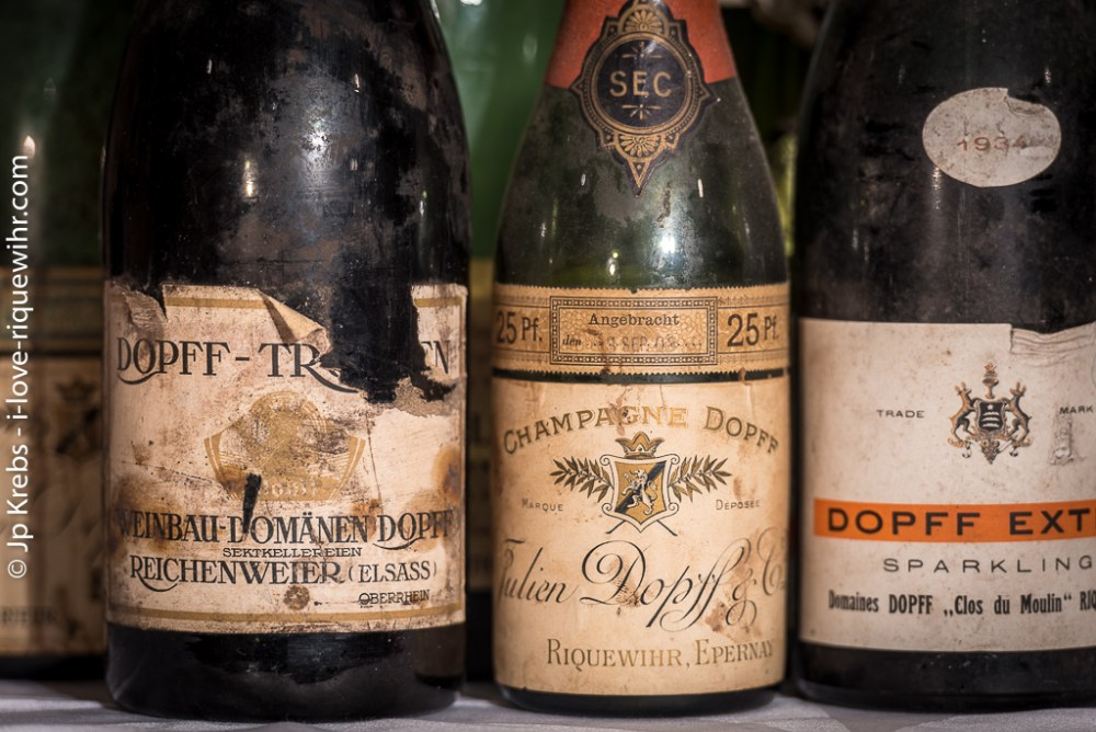 Champagne Dopff and Sekt (German name for an effervescent wine produced according to the Champagne method) before the war of 1914-18. After the war, when Alsace returned to France, Julien Dopff could no longer produce Champagne wines in Riquewihr, nor claim the appellation SEKT. See the bottle on the right (1934) for export.