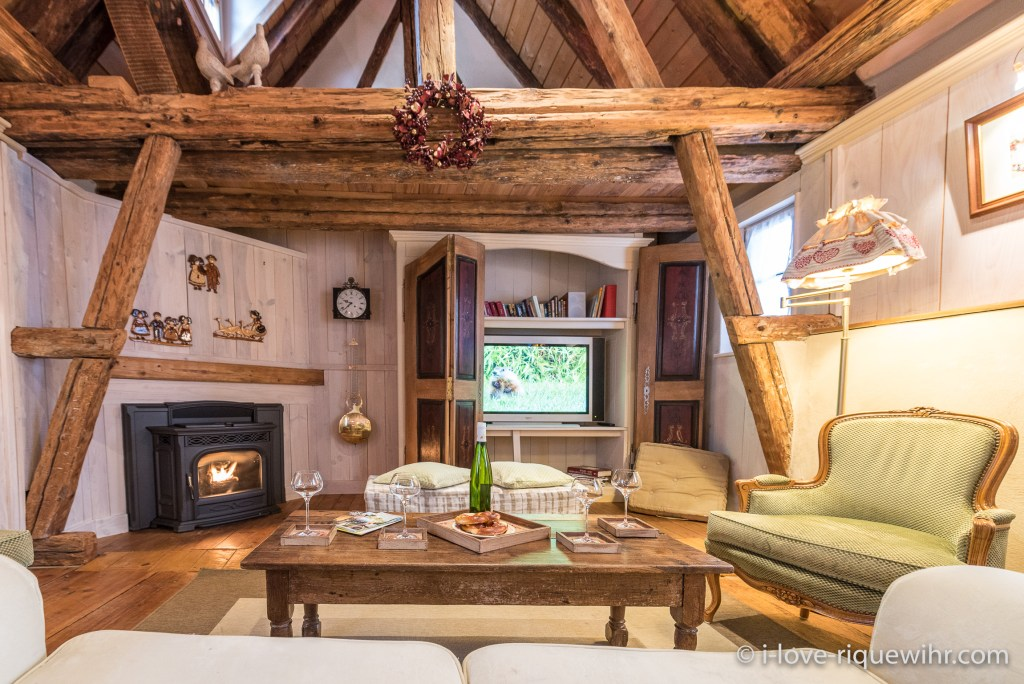 The living room of the Dove's Nest in Riquewihr, one of the most beautiful places available for holiday rental in Alsace on the Alsace Wine Route!