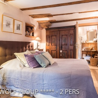 The bedroom of the The Little Wolf, lovely apartment in Riquewihr in Alsace for 2 persons just near the Schœnenbourg vineyard on the Alsace wine route