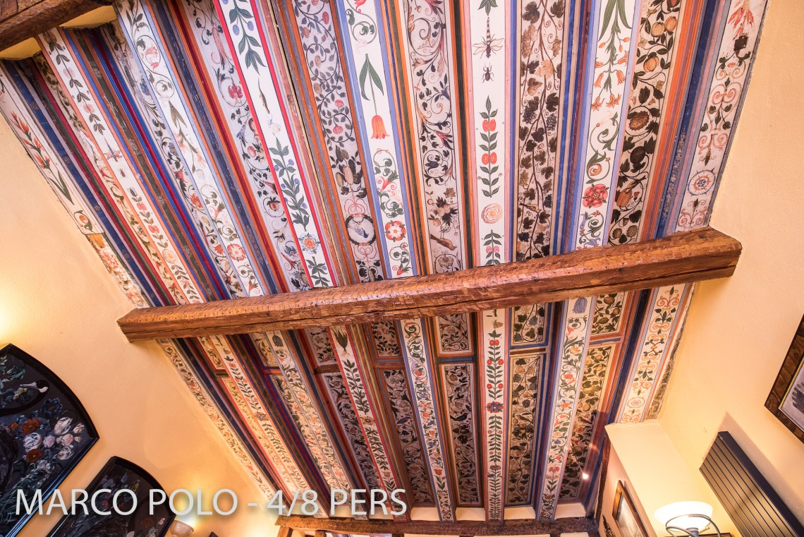 In the living room in Marco-Polo, you can see Alsatian ceiling decoration