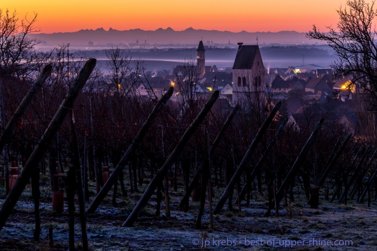 The steeples of Mittelwihr and Bennwihr seen from the top of the Grand Cru vineyard Mandelberg in the heart of winter.