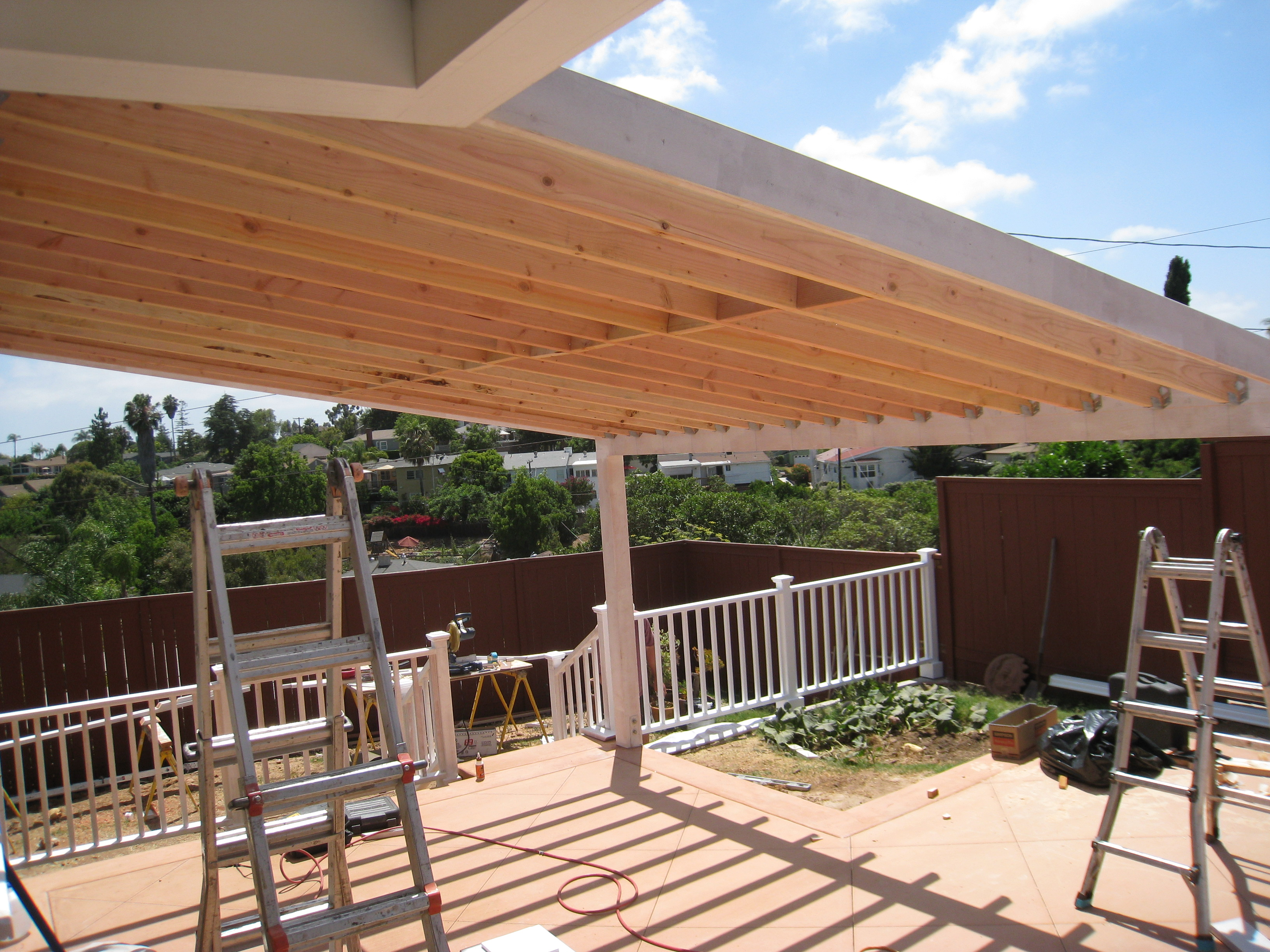 main matchup: wood patio covers versus aluminum patio covers