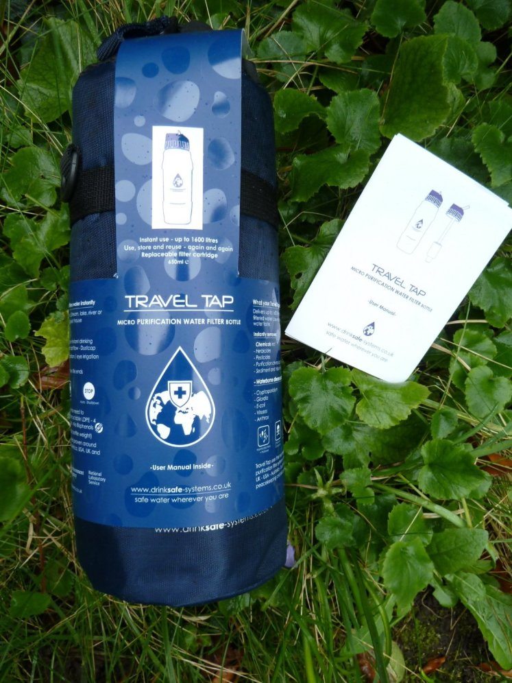 Travel Tap Bottle laying on the ground, the travel tap bottle, is both a filtered bottle, and a reusable bottle, one of the best reusable water bottles is fact.