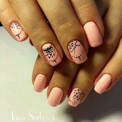 Light Peach Colored Nails With One Glitter