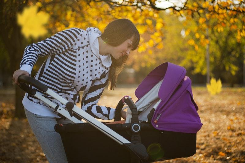 women looking baby stroller