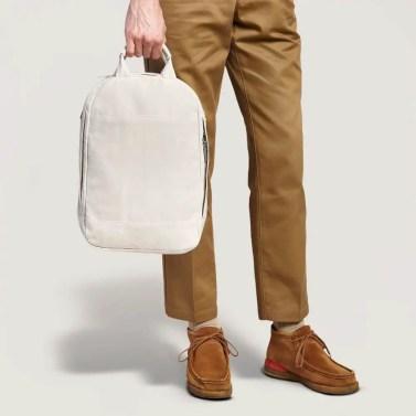 slim backpack held by man
