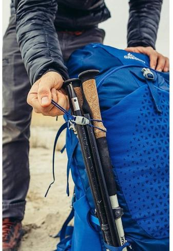 gregory backpack with trekking poles attached