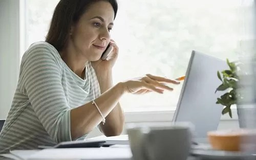 woman using tech at home featured
