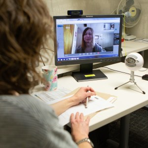 Gwen Merrick interacts with patient Amber Risk via computer using videoconferencing technology known as telemedicine.