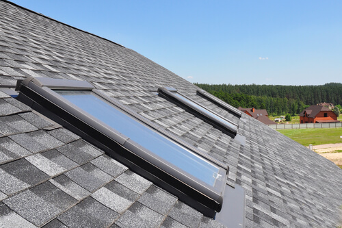 Three skylights on top of house roof