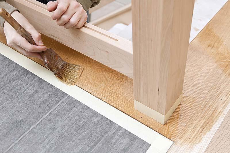 applying water based polyurethane floor finish.