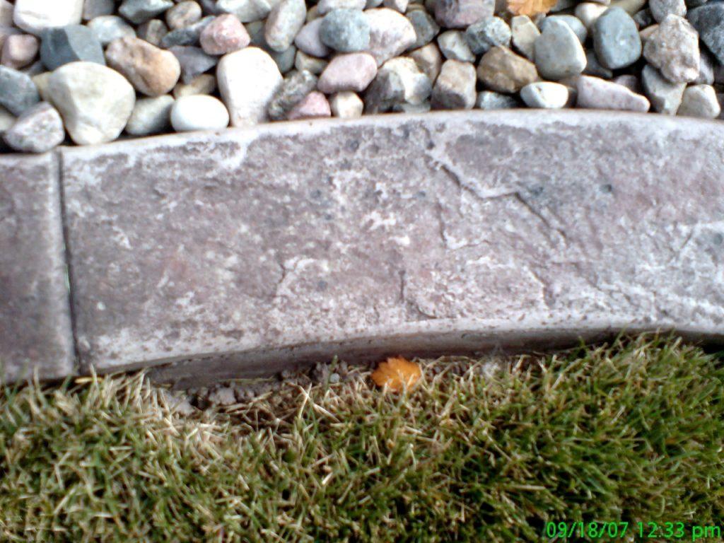 Base-  light sand  Release- walnut, brown, black specks Stamp- slate curb