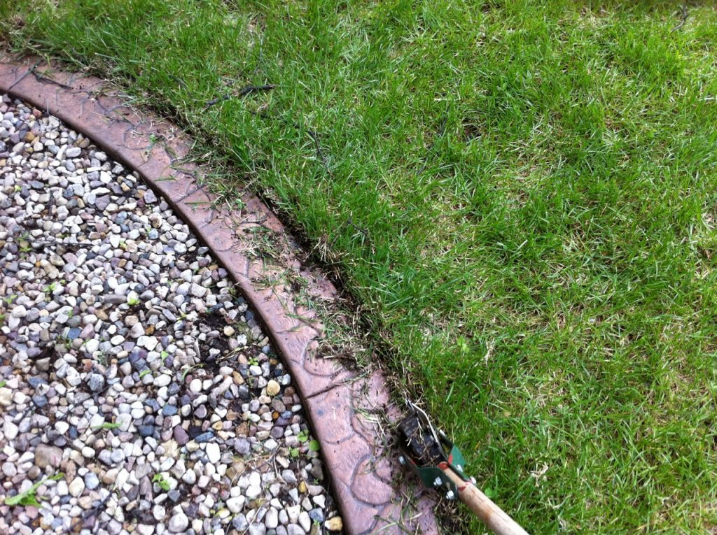 using a manual toothed edger