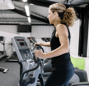 woman doing elliptical trainer workout