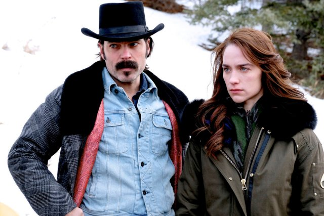 """WYNONNA EARP -- """"No Cure For Crazy"""" Episode 304 -- Pictured: (l-r) Tim Rozon as Doc Holliday, Melanie Scrofano as Wynonna Earp -- (Photo by: Michelle Faye/Wynonna Earp Productions, Inc./Syfy)"""