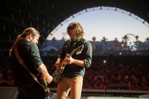 """ASIB-08455 Film Name: A STAR IS BORN Copyright: © 2018 WARNER BROS. ENTERTAINMENT INC. AND METRO-GOLDWYN-MAYER PICTURES INC. ALL RIGHTS RESERVED Photo Credit: Neal Preston Caption: (L-R) LUKAS NELSON as guitarist and BRADLEY COOPER as Jack in the drama """"A STAR IS BORN,"""" from Warner Bros. Pictures, in association with Live Nation Productions and Metro Goldwyn Mayer Pictures, a Warner Bros. Pictures release."""