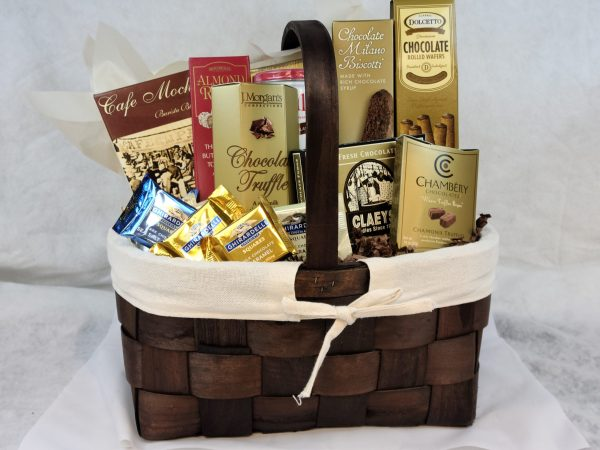 Chocolate Inspirations Gift Whitmans assorted Chocolates, one cafe mocha and one sorrento hot cocoa, Dolcetto Chocolate wafers, Chocolate Milano Biscotti, Proulines, ALmond Roca butter toffee almonds, J Morgans Chocolate Truffles, Claeys Kettle Fresh Chocolate Fudge, Chanberyh Chocolates, and Six Ghirardelli Chocolates. Basket - Conrad Farms Gourmet Gifts