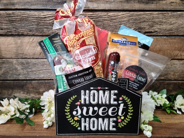 No Place Like home basket conrad farms with meat, cheese, carmel corn, coffee and truffles