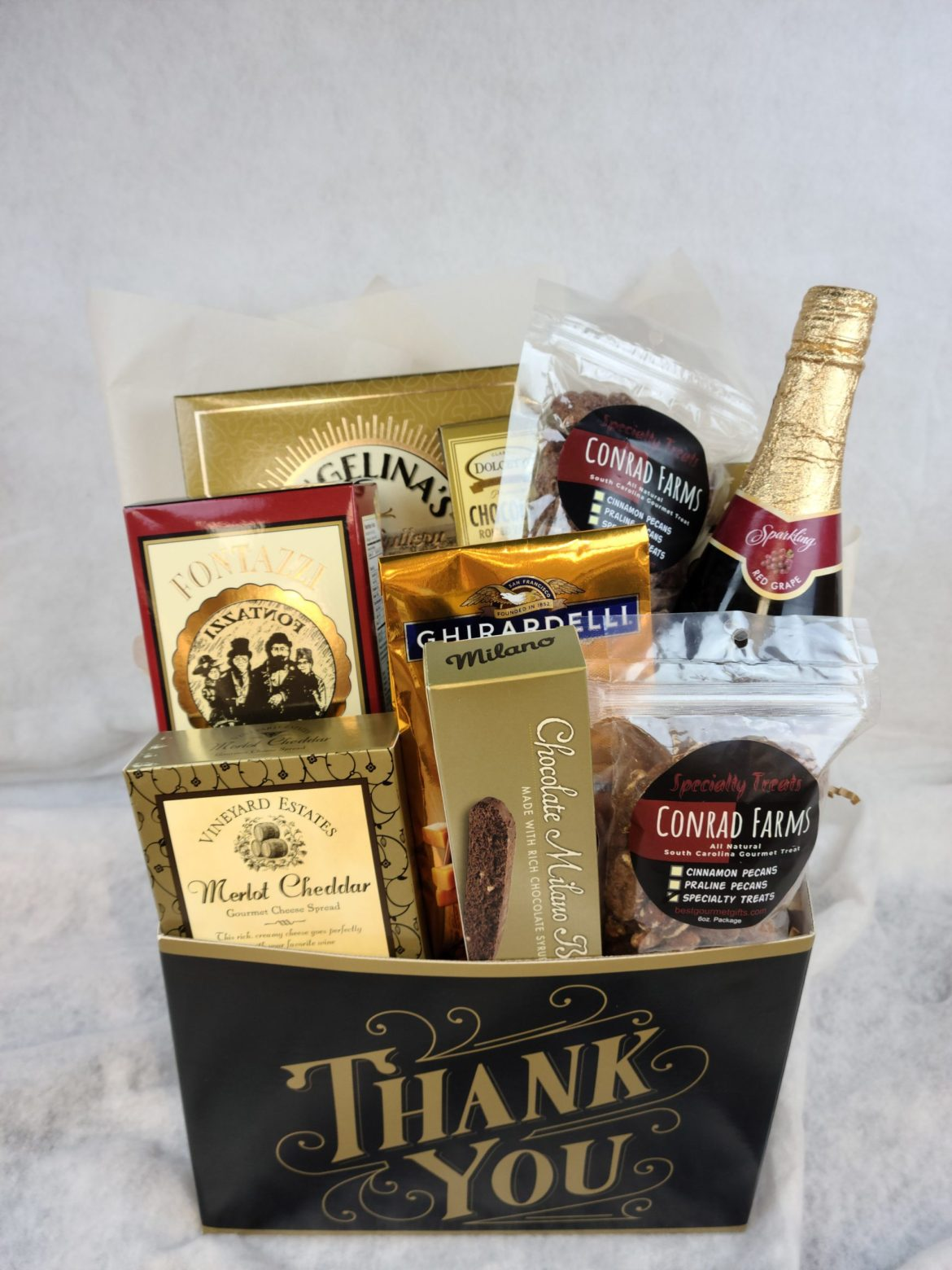 Thank you basket image with sparkling juice and snacks from conrad farms.