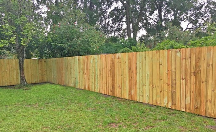 Neighbors side of wood fence