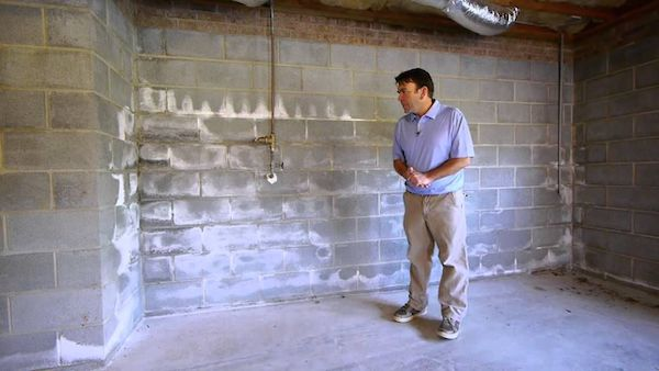 removing white powder from basement walls