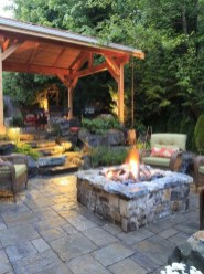 Relaxing Outdoor Fireplace Designs For Your Garden24