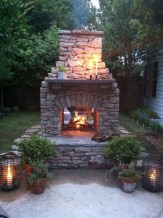 Relaxing Outdoor Fireplace Designs For Your Garden43
