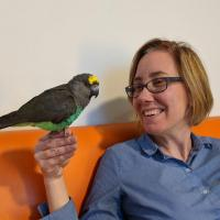 Michelle Underhill, Executive Director of Phoenix Landing Foundation, with one of her parrots