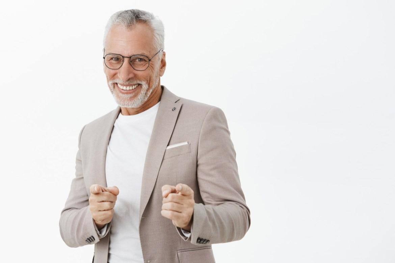 Older man doing finger guns