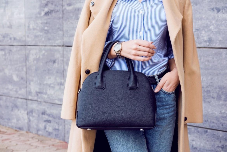 Stylish woman holding purse